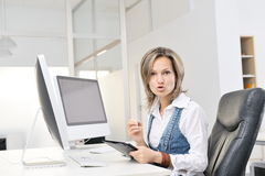 Angry young woman at the office Royalty Free Stock Images