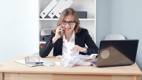 Angry Woman in the office and screams into the phone. Angry young Woman in the office and screams into the phone stock video