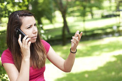 Angry young woman on the phone Royalty Free Stock Photography