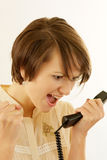 Angry young woman with a phone Royalty Free Stock Photos