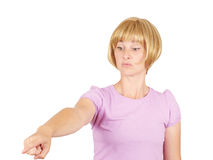 Angry young woman pointing finger. Isolated on  background Stock Photography