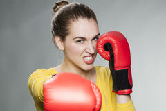 Angry young woman punching and blocking Stock Images