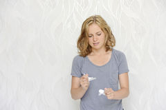 Angry young woman ripping papers Stock Image