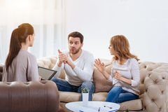 Angry young woman saying something to her husband Stock Image