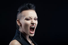 Angry young woman screaming isolated on black background stock photography