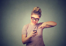 Angry young woman screaming on mobile phone. Negative human emotion Royalty Free Stock Images