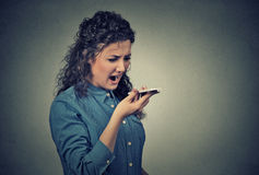 Angry young woman screaming on mobile phone Royalty Free Stock Photo