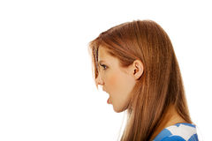 Angry young woman screaming for someone.  Royalty Free Stock Photo
