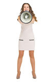 Angry young woman shouting through megaphone Royalty Free Stock Photo