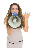 Angry young woman shouting thought megaphone. Isolated on white Stock Images