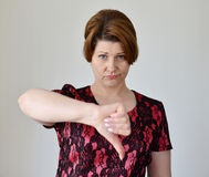 Angry young woman showing thumb down Stock Photography