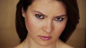 Angry young woman staring at camera stock video