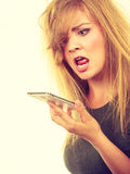 Angry young woman talking on phone Royalty Free Stock Images