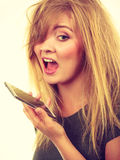 Angry young woman talking on phone Stock Images