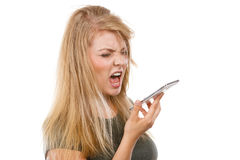 Angry young woman talking on phone. Unpleasant conversation, bad relationships concept. Screaming furiously angry young blonde woman talking on phone. Studio Stock Images