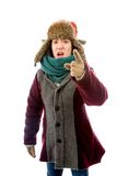 Angry young woman in warm clothing and pointing Royalty Free Stock Photos