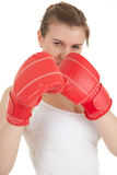 Angry young woman wearing boxing gloves Royalty Free Stock Images