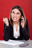Angry young woman at work Royalty Free Stock Photos