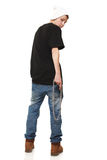 Angry youth. Fashionable youth in jeans leaves having turned Royalty Free Stock Image