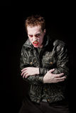 Angry Zombie. Angry young male zombie in black leather jacket Royalty Free Stock Image
