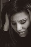 Angst. A woman shows angst, stress, worry,apprehension, overwork, business or financial woes Royalty Free Stock Photos