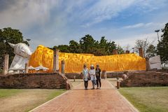 Angthong thailand - april 3,2016 : asian tourist taking a photog. Raph in front of asleeping buddha statue in wat khun inthapramul one of most popular traveling stock photography