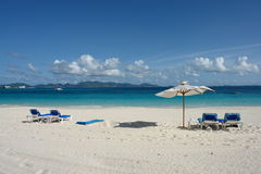 Anguilla. RendezVous Bay beach with beach chairs and umbrella Royalty Free Stock Images