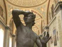 Anguish frozen in time. Statue of anguished figure seen in sculpture at The Hermitage in St Petersburg stock photo