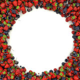 Angular frame of juicy, ripe strawberries, blueberries Stock Photography