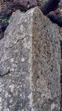 Angular granite rock formation in forest, shown head on to the corner royalty free stock image