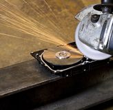 Angular grinder cleaning data from hard drive Stock Photography