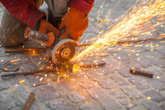 Angular grinding machine cuts metal with sparks. Angular grinding machine cuts metal and sparks Stock Images