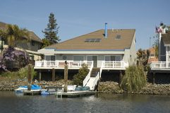 Angular house on the water. Angular modern home in a housing commuinity in Northern California with waterfront access to the delta Royalty Free Stock Photography