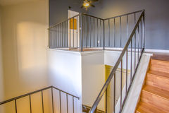Angular stairs showing the spacious loft of a San Diego Townhouse. Top story loft in Southern California townhome Royalty Free Stock Photo