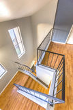 Angular stairs on third floor of San Diego townhouse. Beautiful stairs in Southern California home Royalty Free Stock Images