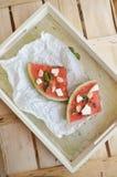 Anguria arrostita organica sana matura con miele Fotografia Stock Libera da Diritti