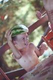 Anguria della tenuta del ragazzo come cappello Fotografia Stock