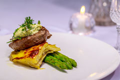 Angus tenderloin with Pommes Boulangerre and asparagus Stock Photography