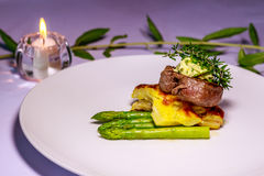 Angus tenderloin with Pommes Boulangerre and asparagus Royalty Free Stock Photography