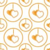 Anhänger in Form von zwei goldenen Herzen im Ring auf der Suspendierung, sharmik Stockfotografie