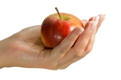 Anhalten eines Apfels Lizenzfreie Stockfotos