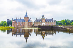 """Anholt Moated Castle. In the western part of Münsterland is one of Germany's few privately owned castles. The """"fat tower"""" dating from the 12th century Royalty Free Stock Photo"""