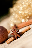 Anice cinnamon and bauble christmas decoration in gold. Macro closeup card stock image