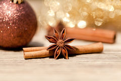 Anice cinnamon and bauble christmas decoration in gold. Macro closeup card stock photo