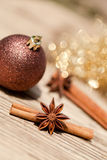 Anice cinnamon and bauble christmas decoration in gold. Macro closeup card stock photos