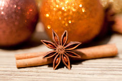 Anice cinnamon and bauble christmas decoration in gold. Macro closeup card royalty free stock images