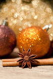 Anice cinnamon and bauble christmas decoration in gold. Macro closeup card stock photography