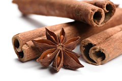 Anice and cinnamon. Macro of anice and cinnamon isolated on white background stock photos