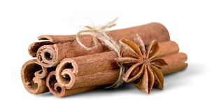 Anice and cinnamon sticks on background. Stick sticks cinnamon anice color group white royalty free stock photo