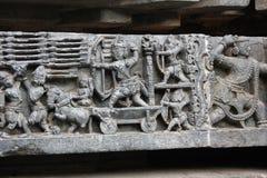 Anicent-Kriegsszene dargestellt auf dem Wandschnitzen von hoysaleswara Tempel Stockbild